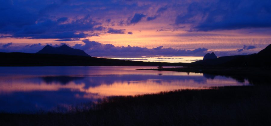 blue and gold sunset over Loch Assynt with Canisp and Suilven in silhouette
