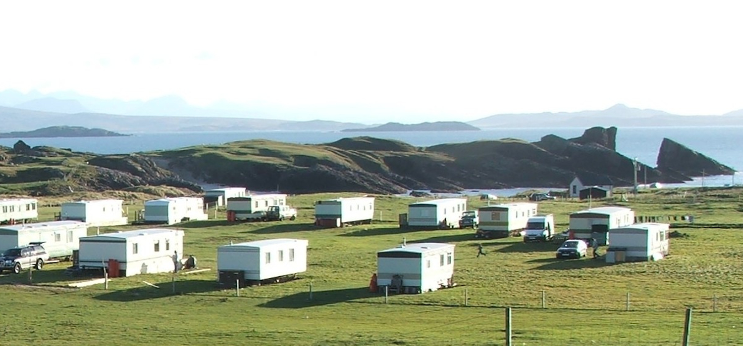 Clachtoll Holidays Caravan Park with split rock and Wester Ross