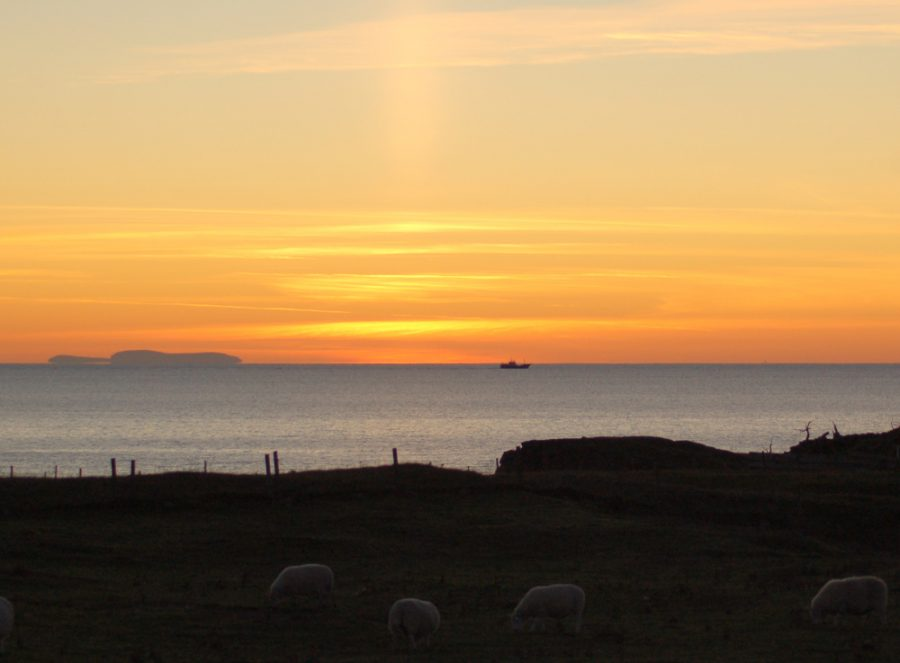 view from caravan at sunset over to Skye
