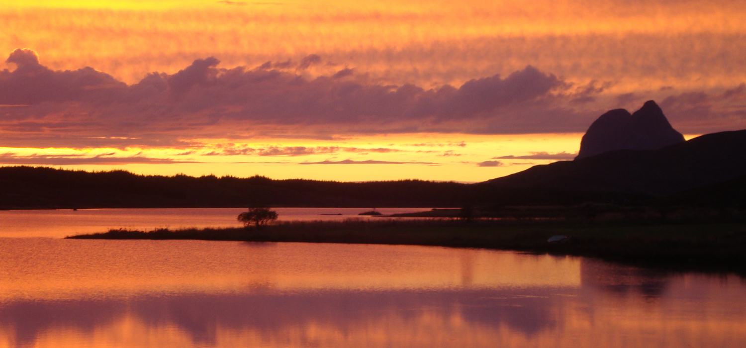 sunset over Loch Assynt with Suilven in silhouette